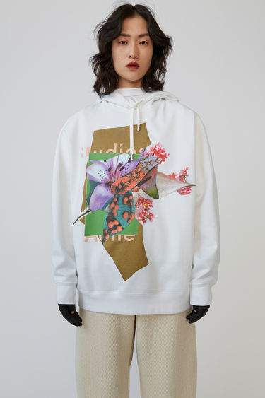 Acne Studios green/multi hooded sweatshirt is cut to an oversized fit and features a collage of flower prints.
