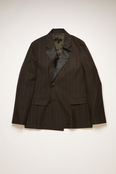 Acne Studios cacao brown pinstriped jacket is tailored with crinkled satin lapels and padded shoulders and wrapped over the front with concealed buttons.