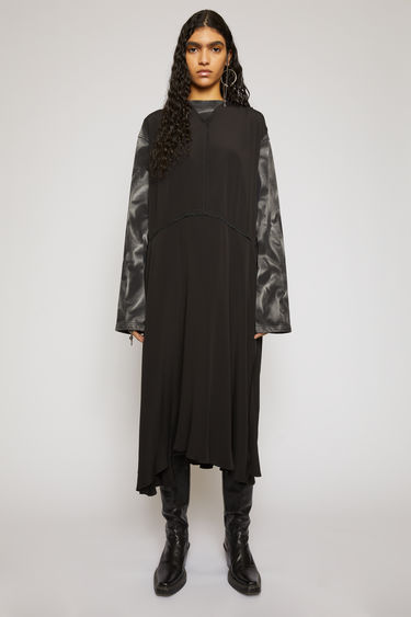 Acne Studios black sleevess dress is made from silk-blend crepe that falls in a fluid drape. It's shaped with a lightly gathered neckline that dips to a V at the front and has an asymmetric midi-length hem.