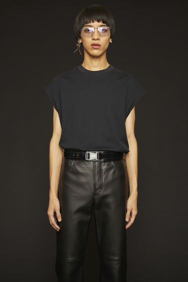 Acne Studios black t-shirt is cut to a boxy shape from lightweight jersey and shaped with a round neck and cap sleeves.