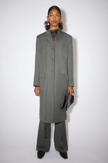 Acne Studios grey/black single-breasted striped coat is made of a linen blend with a relaxed fit.