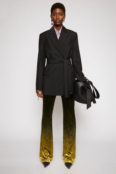 Acne Studios black suit jacket is crafted from a lightweight wool and mohair blend and features a concealed double-breasted placket and a matching tie belt.