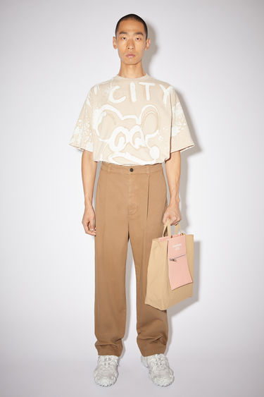 Acne Studios camel brown wide leg trousers are made of cotton with a slight stretch.