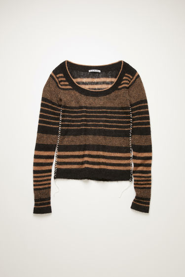 Acne Studios black/camel sweater is knitted from an alpaca and wool-blend and features a stripe jacquared pattern. It's crafted with a scoop neck and long fitted sleeves and accented with whipstitching along the side seams.