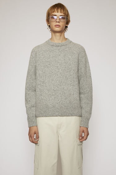 Acne Studios medium grey melange sweater is knitted from soft wool-blend and completed with a ribbed crew neck, cuffs and hem.