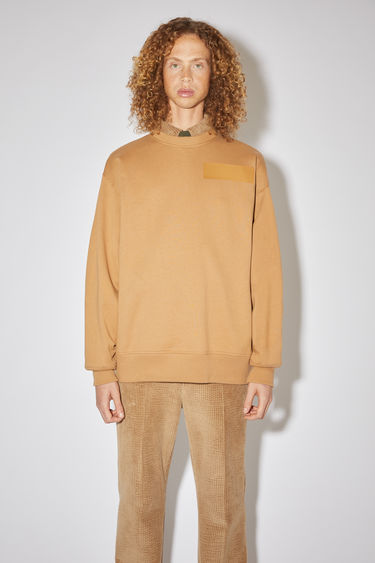 Acne Studios camel brown oversized sweatshirt is made of cotton with a print at the chest and back, in collaboration with Dizonord, a record store in Paris, France.
