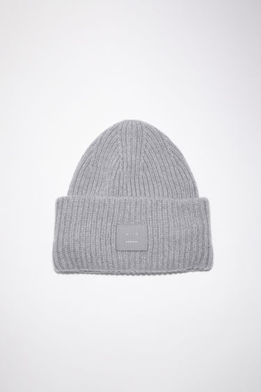 Acne Studios grey melange beanie hat is made from rib knit wool with a face logo patch.