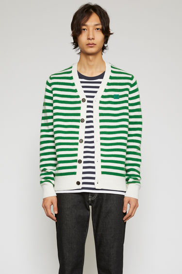Acne Studios green/white stripe sweater is knitted in a fine gauge from soft wool yarns and accented with a tonal face-embroidered patch on the chest.