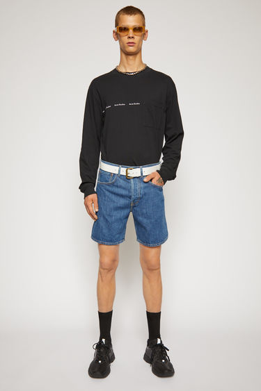 Acne Studios dark blue shorts are crafted from rigid denim that's stonewashed for vintage appeal. It's shaped to a mid-rise silhouette with straight legs that cropped above the knees.
