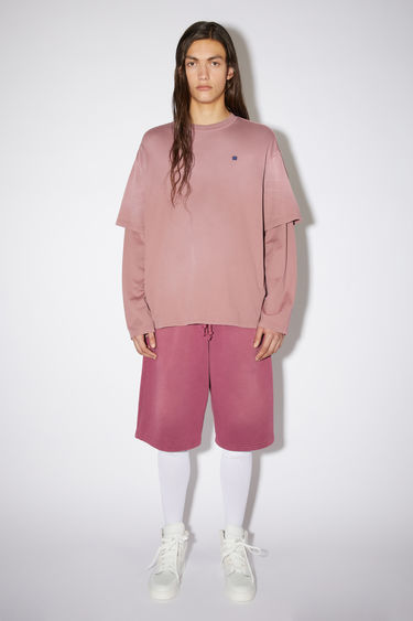 Acne Studios dark mauve relaxed fit t-shirt is made of organic cotton jersey and features the layered look of a short and long sleeved t-shirt.