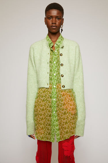 Acne Studios pistachio green cardigan is crafted from an alpaca-wool blend to a boxy silhouette and neatly finished with ribbed edges around the neckline, cuffs and hem.