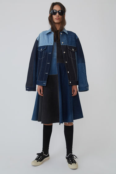 Acne Studios 2000 Recrafted blue mix denim jacket is recrafted from deadstock denim with panelled construction. It is shaped to an oversized silhouette with dropped shoulders. This style is designed for an oversized fit.