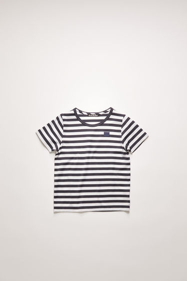 Acne Studios navy blue striped t-shirt is cut from a lightweight cotton jersey with a classic crew neck and short sleeves and accented with a tonal face-embroidered patch on front.