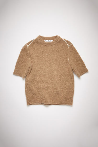 Acne Studios light brown short sleeve sweater is made of a soft, luxurious alpaca blend with a shrunken fit.