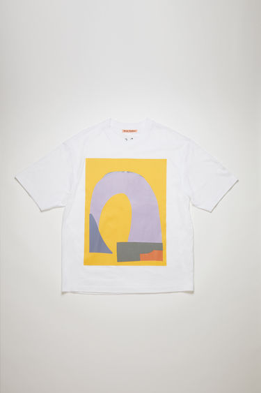 Acne Studios presents a series of unisex t-shirts, created in collaboration with artist Daniel Silver. This white/yellow t-shirt features an abstract collage that's assembled by hand, using fragments of metallic and glitter-coated fabrics. It's crafted to an oversized silhouette with a ribbed crew neckline and dropped shoulders.