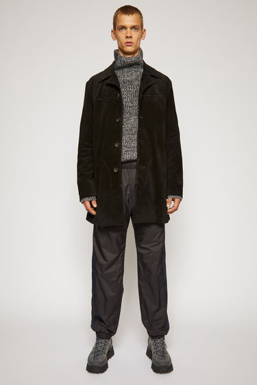 Acne Studios black shirt jacket is crafted from supple suede and features notch lapels, button closure and two D-shaped patch pockets on the front.
