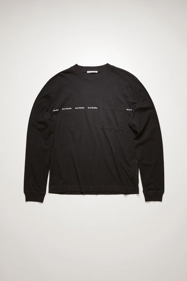 Acne Studios black t-shirt is crafted from organically grown cotton to a relaxed silhouette with a front patch pocket and long sleeves and is stamped with the house's logo across the chest.