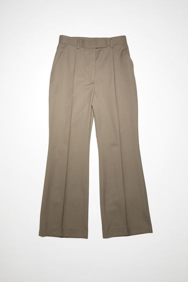 Acne Studios taupe grey suit trousers are made of a wool blend with a high waisted, straight leg fit and cropped, flared hems.