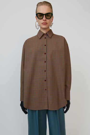 Acne Studios blue/brown shirt is cut to an oversized fit and patterned with a check print.