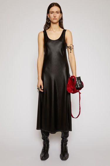 Acne Stuios black satin dress is crafted from satin with a round neckline that falls in a fluid drape through the skirt and finished with contrasting stitching along the side seams and hem.
