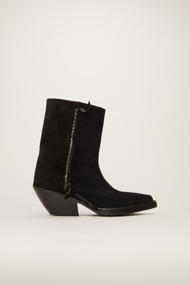 Acne Studios black boots offer a contemporary take on the traditional cowboy boots. Crafted from suede, they rest on a slanted stacked heel and are accented with leather knots and whipstitched seams.