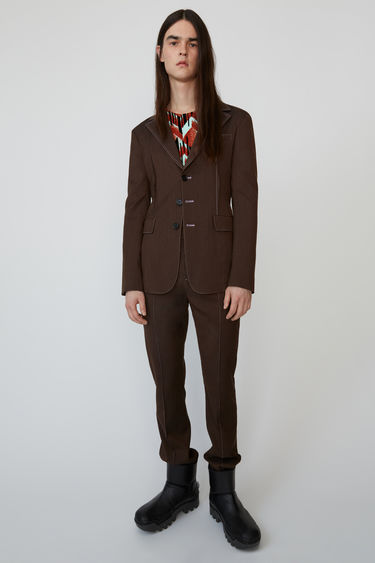 Acne Studios almond/cognac pinstripe jacket finished with contrasting topstitches.