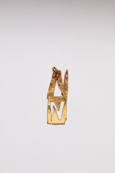 Acne Studios pendant is crafted from a hammered gold-tone brass and features a stencil of the letter 'N'  The pendant can be personalised with a chain necklace.
