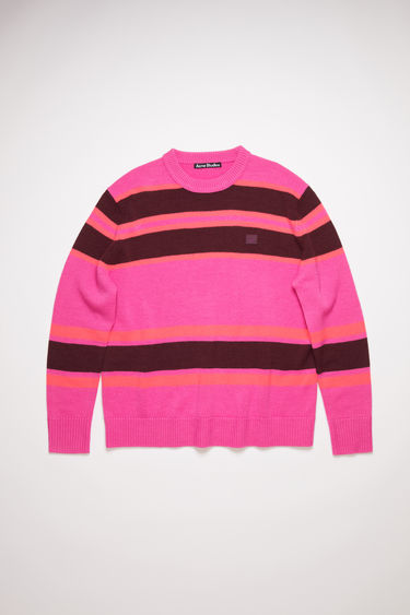Acne Studios pink/burgundy striped crew neck sweater is made from wool with a face logo patch and ribbed details.