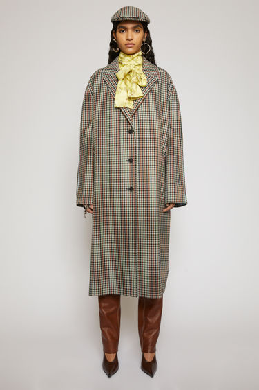 Acne Studios beige/brown coat is crafted from recycled wool that has a woven check pattern. It has a loose single-breasted shape with dropped sleeves, notch lapels and a martingale strap at the back, and is finished with contrasting piping along the shoulders and front welt pockets.
