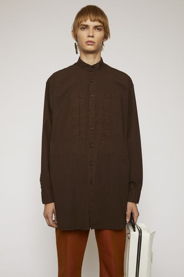 Acne Studios coffee brown shirt is crafted from silicon-washed cotton and features a neat grandad collar and two front pockets.