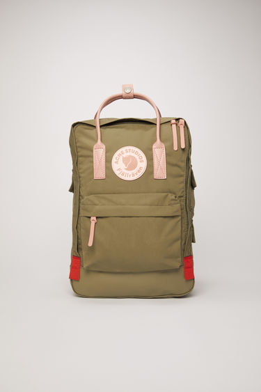 "Acne Studios Kånken Tarpaulin A/F olive green is a variant on the Kånken 15"" laptop bag, updated with luxury finishes. A collaboration between Fjällräven and Acne Studios, with co-branded details."