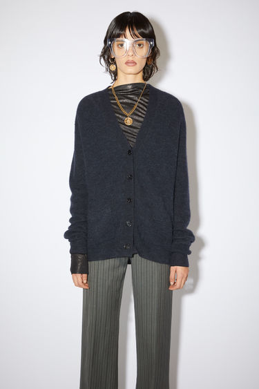 Acne Studios charcoal grey sweater is made of a soft knit with a relaxed fit.