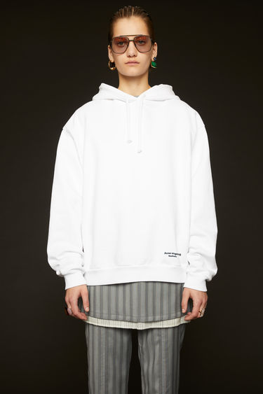 Acne Studios optic white hooded sweatshirt is cut to an oversized fit from cotton jersey and features contrasting tape that's purposefully applied with irregular folds at the side seams.