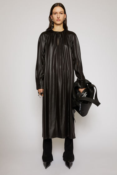 Acne Studios black satin dress falls with a fluid drape from the gathered neckline to a clean, straight hem and features exaggerated slits on the sleeves that can be left open or fastened with buttons.