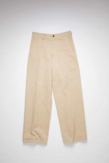 Acne Studios hazel beige casual workwear trousers are made of cotton twill with a wide leg.