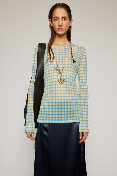 Acne Studios blue top is crafted from lightweight stretch jersey and features the seasonal check pattern. It's shaped with a crew neck and long, close-fitting sleeves and is purposefully finished with loose hanging threads at the hem.