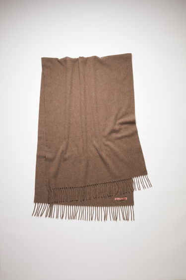 Acne Studios mushroom beige melange oversized fringed scarf is made of pure wool, featuring a label in one corner.