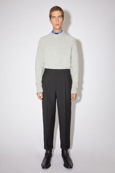 Acne Studios black casual trousers are made of wool/mohair blend with a tapered fit.
