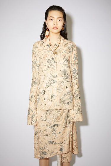 Acne Studios beige long sleeve shirt is made of printed jacquard with a fitted silhouette.