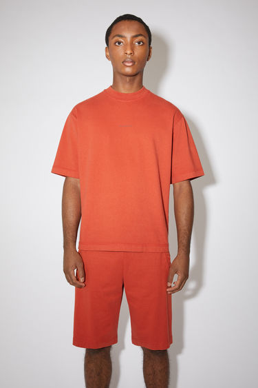 Acne Studios copper crew neck t-shirt is made of cotton, featuring a front logo print.