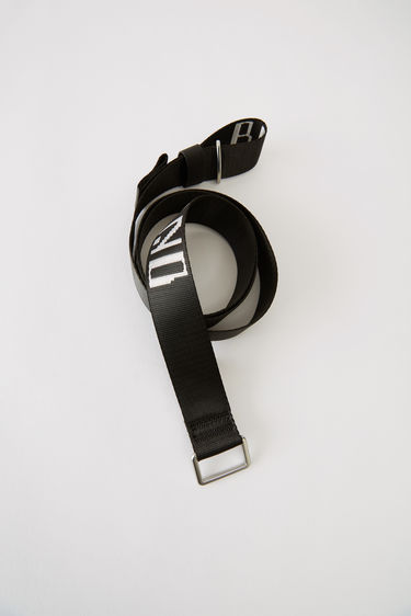 Acne Studios Blå Konst Welte Brand black/white is a branded webbing belt.
