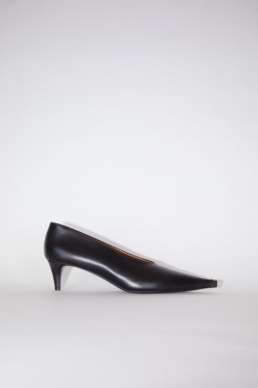 Acne Studios black kitten heel pumps are made of calf leather with long, pointed toes.