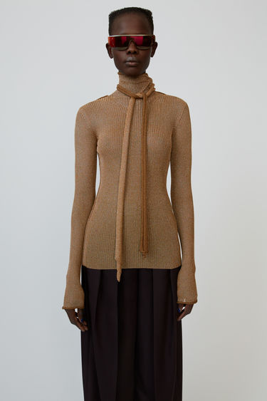 Acne Studios light brown sweater is crafted from metallic knitted lurex and shaped with a high neck with a long tie strap.