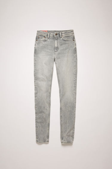 Acne Studios Peg Stone Grey jeans are crafted from super stretch denim that's washed to give a worn-in appeal. They're cut to a high-rise waist with a skinny cropped leg and accented with subtle whiskering.