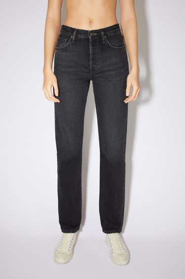 Acne Studios black jeans are made from rigid denim with a high rise and a regular leg.