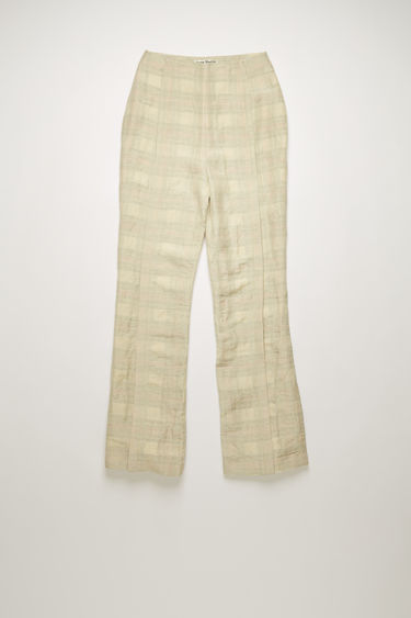 Acne Studios cream/orange checked trousers are crafted from a blend of cotton and linen and shaped with slim, flared legs with pressed folds on front.