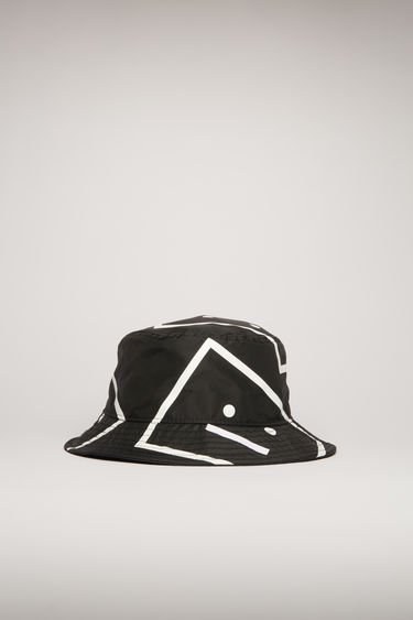 Acne Studios black nylon bucket hat is crafted with a flat-topped crown and quilted brim and patterned all over with the house's signature face motif in blown up proportions.