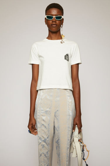 Acne Studios optic white t-shirt is crafted from slubbed cotton jersey to a slim fit and features a print of Acne Studios' headquarter on the chest.