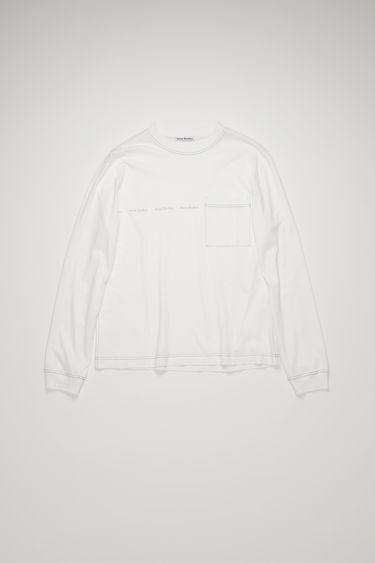 Acne Studios optic white t-shirt is crafted from organically grown cotton to a relaxed silhouette with a front patch pocket and long sleeves and is stamped with the house's logo across the chest.