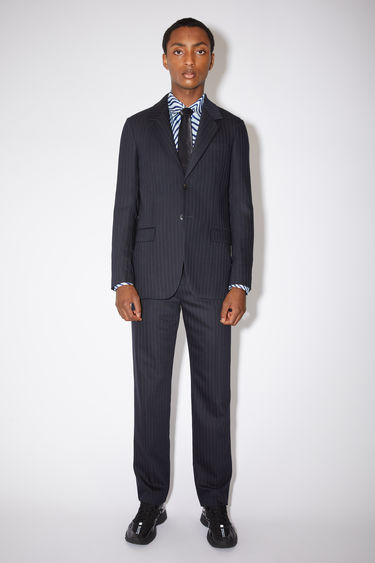 Acne Studios navy/white constructed suit jacket is made of a pinstripe wool blend with a slight stretch.